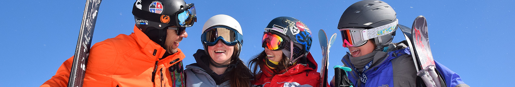 Smiling skiers and snowboarders